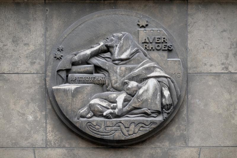 Averroes, was a medieval Andalusian polymath. He wrote on logic, philosophy, medieval sciences of medicine, astronomy, physics. Stone relief at the building of royalty free stock photo