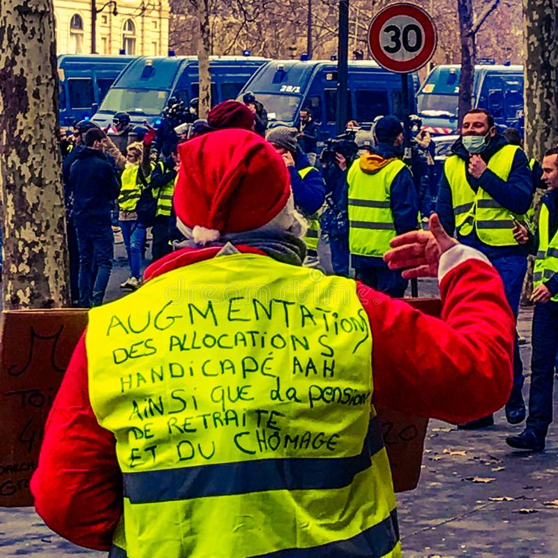 Demonstrators during a protest in yellow vests royalty free stock photo