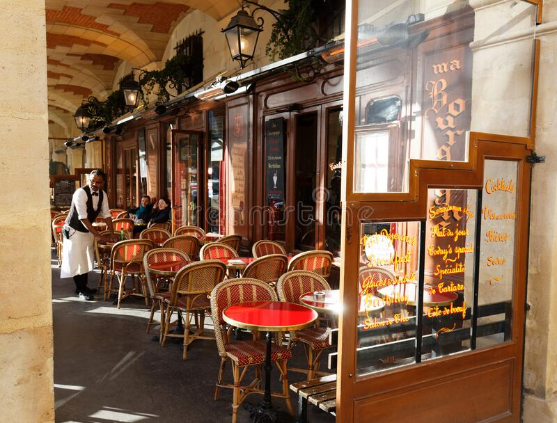The French traditional restaurant Ma Bourgogne located on Place des Vosges in Le Marais quarter, Paris, France. royalty free stock photo