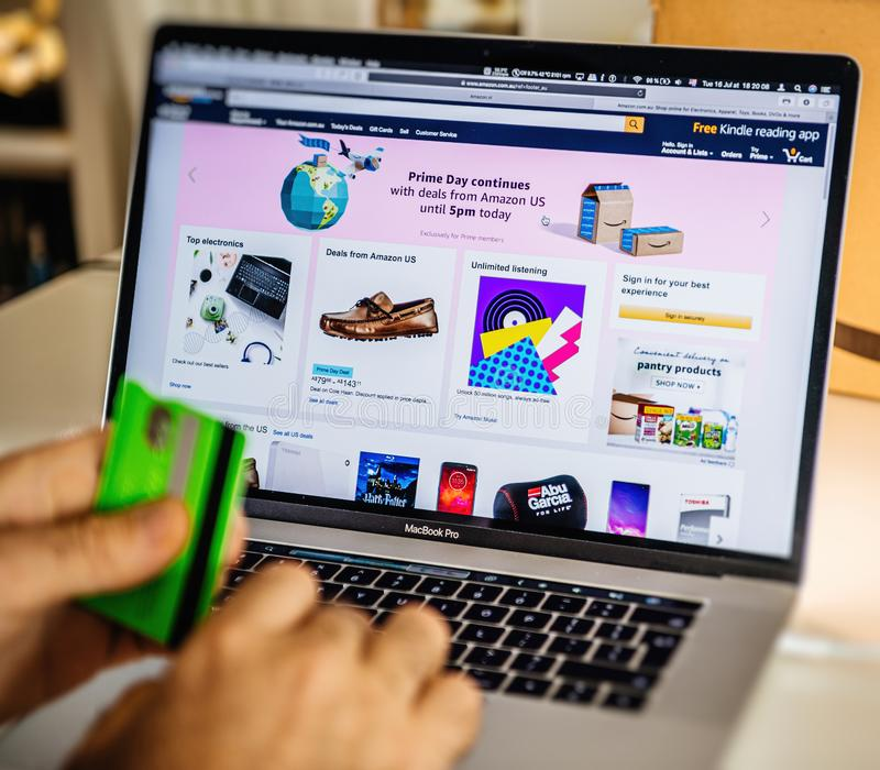 Amazon Prime day man shopping on laptop deals stock photography