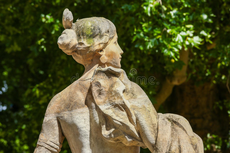 Paris, France - Jul 14, 2014: Old statue in Champs elysees garden in Paris, France royalty free stock photography