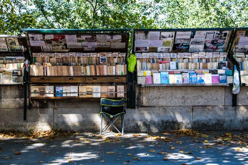 Quai de Montebello, a bouquiniste bookeller station udenr the shadows of the trees. Paris V stock photo
