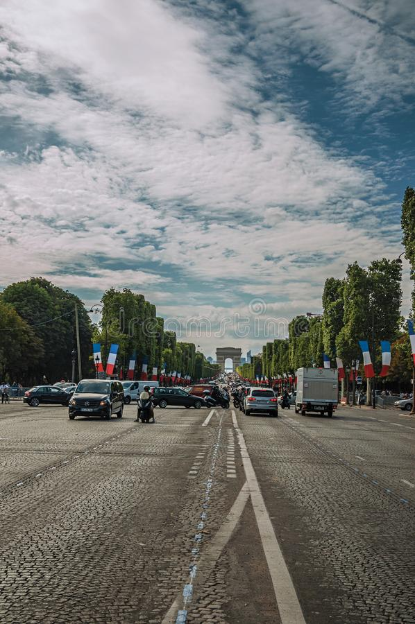 Trees and cars on the bustling Champs-Elysees Avenue in Paris. stock photo