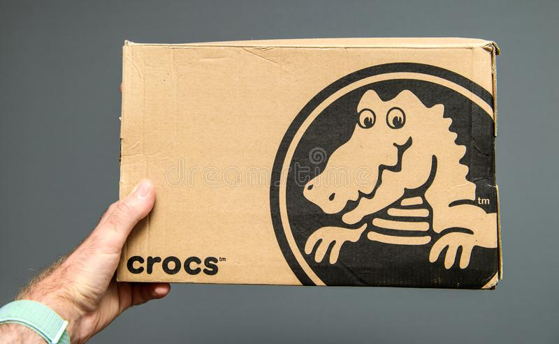 Crocs shoes cardboard box gray background stock images