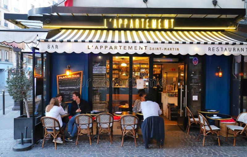 Appartement Saint-Martin is traditional French restaurant located at Boulevard Bonne Nouvelle near Porte Saint Denis in. Paris, France-June 10, 2019 stock photos