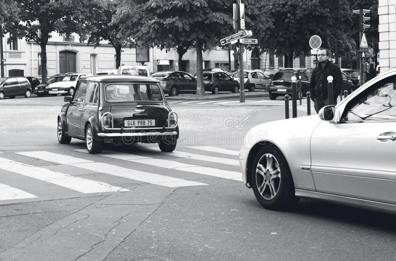 PARIS, FRANCE: June 06, 2013 - Car Mini Cooper S 1968, in Paris, stopped in front of the street pedestrian pedestrian royalty free stock photo