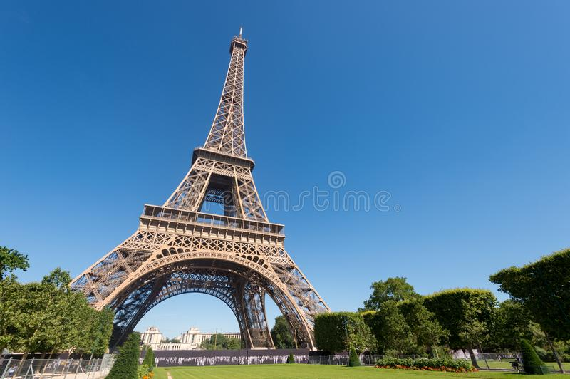 Eiffel Tower from the Champ de Mars gardens in summer. stock image