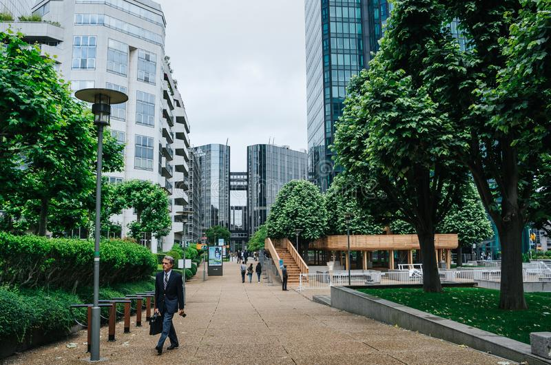 PARIS, FRANCE - JUNE 27, 2016: People, walk in La Defense, commercial, business district of the city. Urban citylife scene stock photography