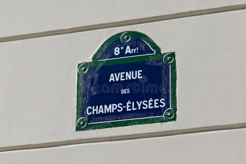 PARIS, FRANCE - JUNE 23, 2017: Plaque with the name of the famous french street Avenue des Champs-Elysees on the wall of an stock photography