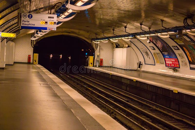 PARIS, FRANCE - JUNE 2014: Tunnel on metro station in Paris. PARIS, FRANCE - JUNE 2014: View of empty tunnel at metro station. It is the second-busiest subway stock photography