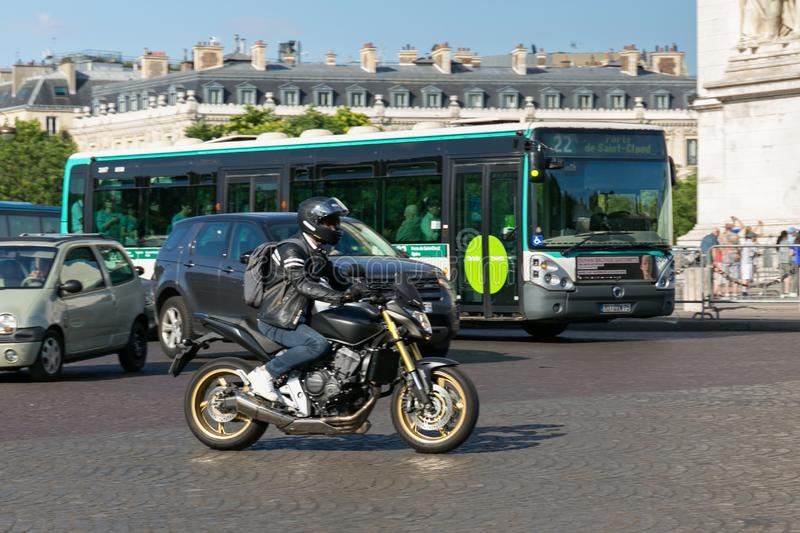 PARIS, FRANCE - JUNE 23, 2017: Unknown adult male on a motorcycle in the center of Paris. At summertime royalty free stock photo