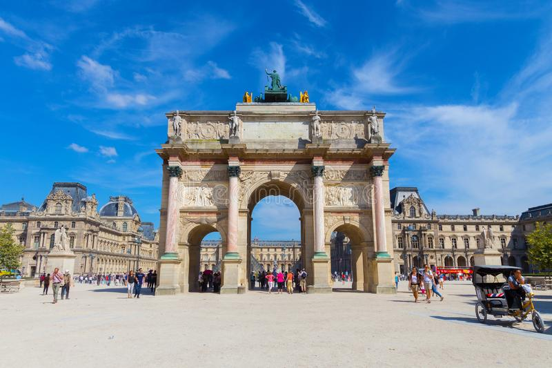 PARIS, FRANCE - JUNE 23, 2017: View of the Arc de Triomphe du Carrousel in historical center of Paris and famous Louvre Palace in royalty free stock photography