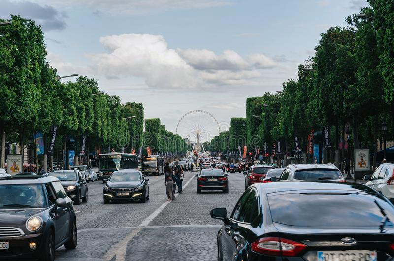 PARIS, FRANCE - JUNE 25, 2016: View of Champs-Elysees in dusk - the most famous avenue of Paris has 1910m and is full of stores, royalty free stock image
