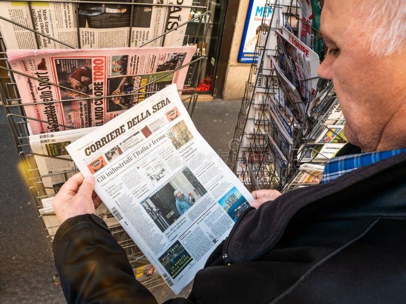 Senior man buying press newspaper kiosk press corriere della sera royalty free stock images