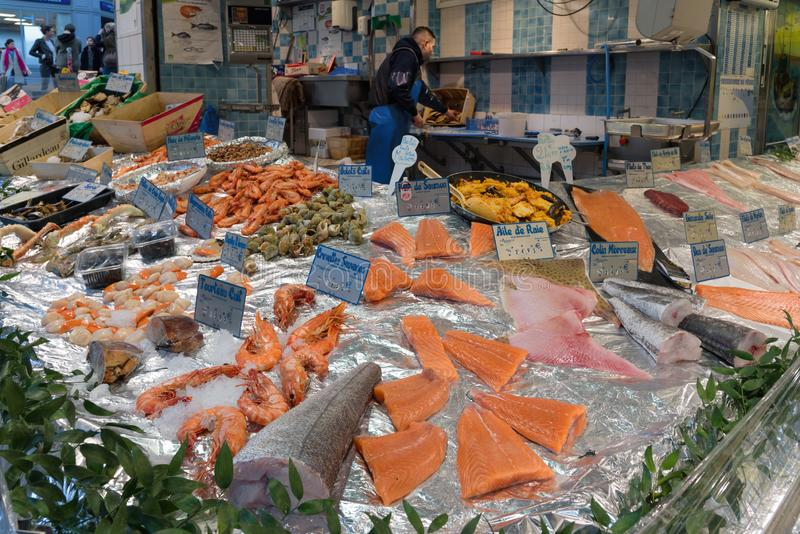 Fresh fish and seafood store in Montmartre, Paris. Paris, France - 24 March 2019: assortment of fresh fish and seafood at a local store in Montmartre, Paris royalty free stock photography