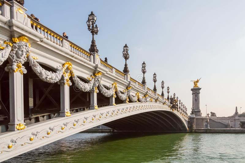 Pont Alexandre III Bridge. Paris, France - March 23, 2015: In Paris on a sunny Spring day sits the Pont Alexandre III bridgee over the Seine river stock image