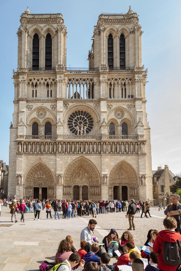Paris, France, March 27, 2017: School group excursion following the lesson of the tour guide near the western facade of stock photos
