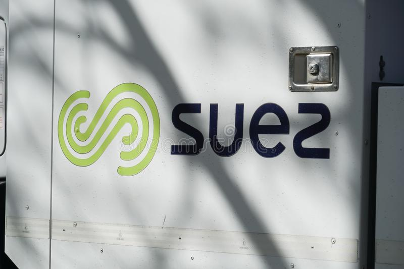 Suez Environnement company sign. Paris, France - March 19, 2019: SUEZ emblem. Suez Environnement SA is a French-based utility company which operates largely in stock photography