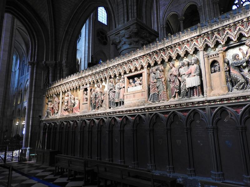 Paris, France - March 31, 2019: 14th Century wood reliefs in Notre-Dame de Paris Cathedral telling the story of the life of Jesus. Christ. Memorials to various stock photos