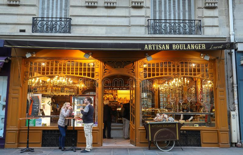 The traditional French bakery shop A la fontaine du Mars located near Eiffel tower in Paris, France royalty free stock image