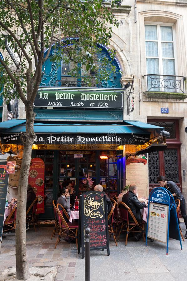 The traditional French restaurant La Petite Hostellerie located near Saint Michel boulevard in Paris, France. stock photo