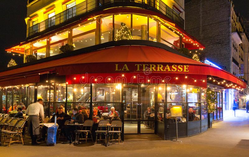 The Typical French Cafe La Terrasse At Night Paris France