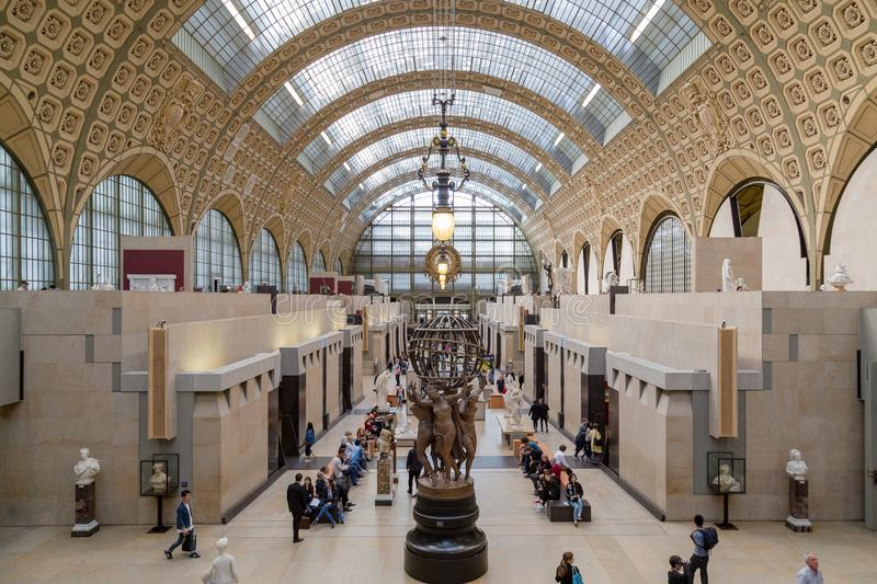 Paris, France, March 28 2017: Visitors in the Musee d`Orsay in Paris, France. The museum houses the largest collection royalty free stock photos