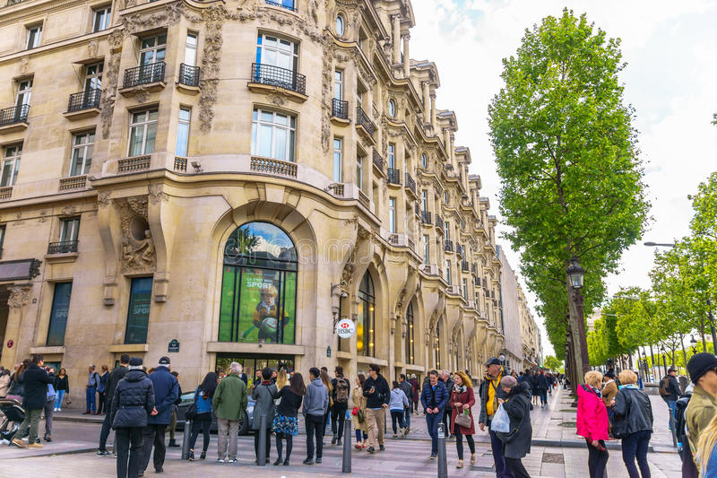 Paris, France - May 1, 2017: Beautiful architecture on Champs-Élysées Avenue with a crowd on May 1, 2017, at Paris, France. stock photography