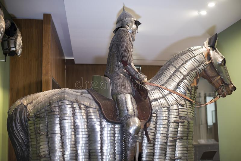 Knight and his horse in steel armor. Museum of Orsay stock image
