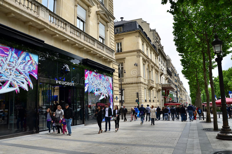 Paris, France - May 14, 2015: Local and tourists on the Avenue des Champs-elysees stock photos