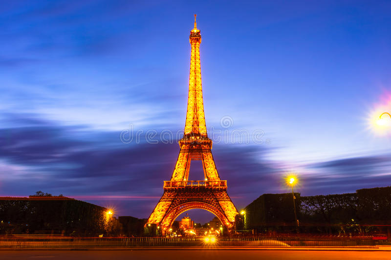Paris, France - May 1, 2017: Long Exposure view of Eiffel tower, view from Champ de Mars in the twilight with a blue sky in royalty free stock image