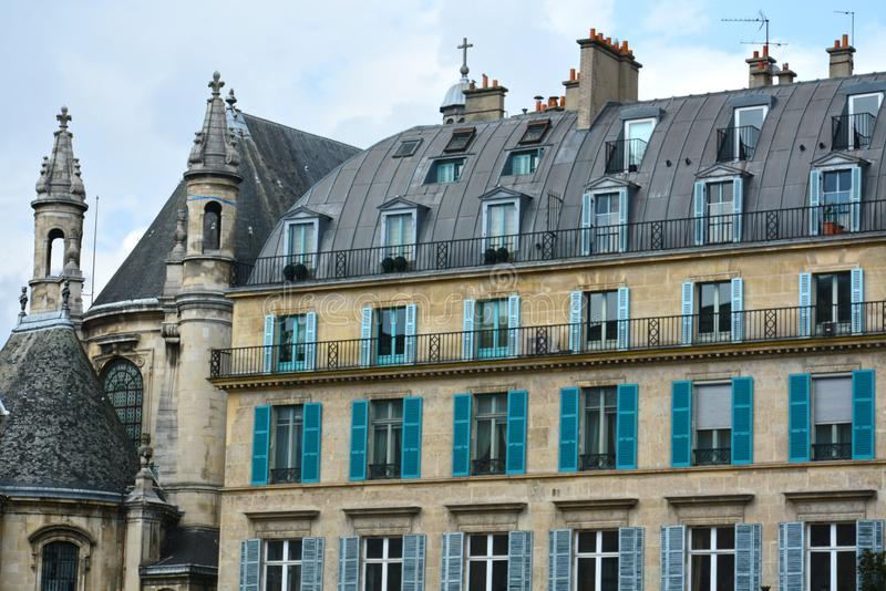 Old historical buildings in central part of Paris on the Rue de Rivoli. PARIS, FRANCE - MAY 25, 2019: Old historical buildings in central part of Paris on the royalty free stock images