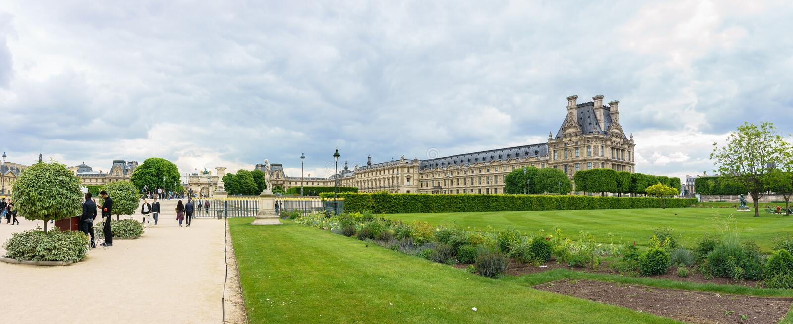 Paris, France - May 2, 2017: Panorama views of the Louvre buildings in the main courtyard (Cour Napoleon) of Louvre Museum views stock photo