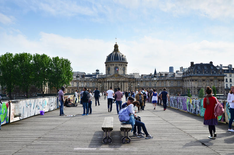 Paris, France - May 13, 2015: People visit Institut de France and the Pont des Arts stock photography