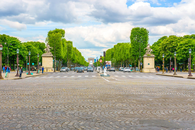 Paris, France - May 3, 2017: Road traffic conditions of Champs-Elysees Avenue views from Place de la Concord with blue cloudy day. Background on May 3, 2017, in stock photography
