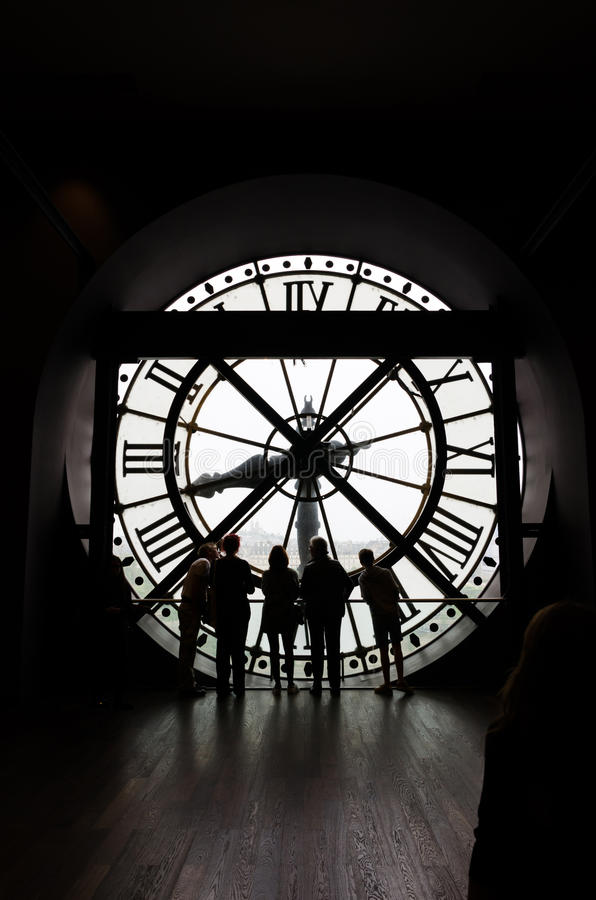 Paris, France - May 14, 2015: Silhouettes of unidentified tourists in the museum D'Orsay. Paris, France - May 14, 2015: Silhouettes of unidentified tourists stock photo