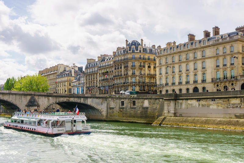 Paris, France - May 1, 2017: Tourists are cruising on the Seine stock images