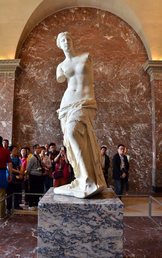 Paris, France - May 13, 2015: Tourists visit The Venus de Milo statue at the Louvre Museum. In Paris. The Venus de Milo statue it's one of most important statue royalty free stock photos
