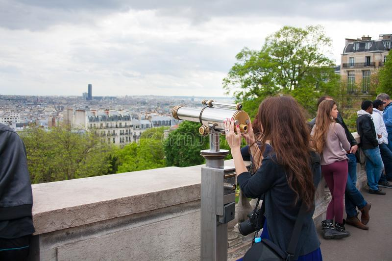 Paris, France - May 13, 2013: Young beautiful woman on observation deck in Montparnasse building in Paris, France. stock photo