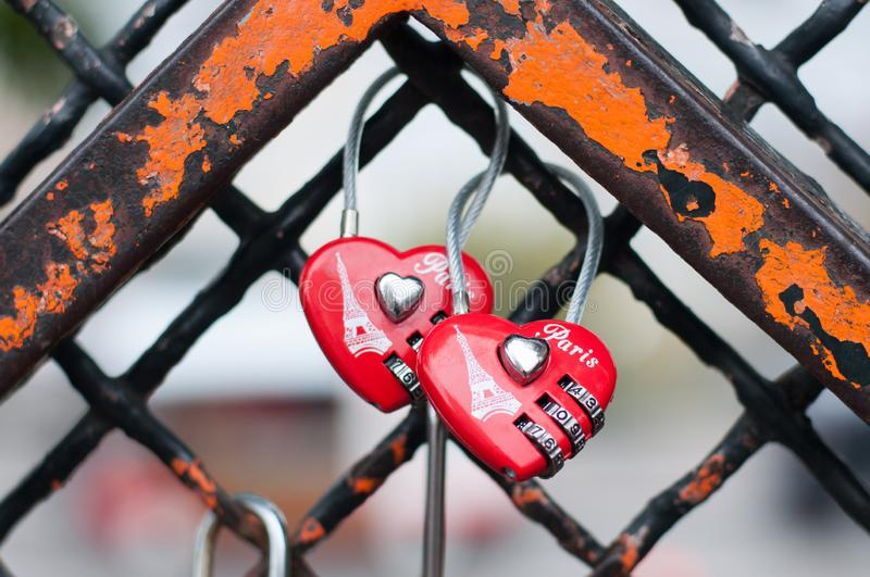 Paris, France, 11.22.2018 Montmartre, Old Rusty Fence with 2 red memorable hearts locks with the image of the Eiffel Tower royalty free stock photo