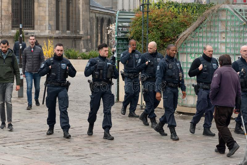 French riot policemen protecting Paris from violent attacks of yellow vests Gilets jaunes protesters. Paris, France - 22nd March, 2019: French police and armed royalty free stock image