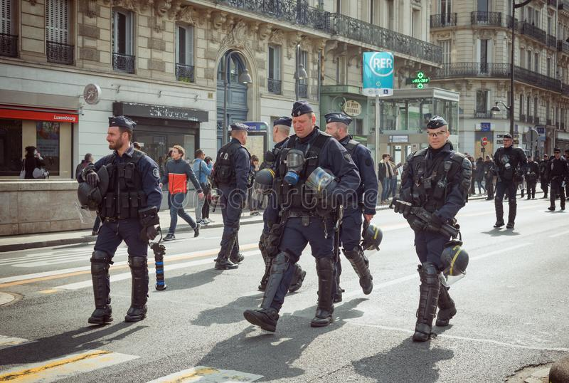 Armed riot police during yellow vests Gilets jaunes protest in Paris. Paris, France - 22nd March, 2019: French policemen and armed forces marching in the street stock photo