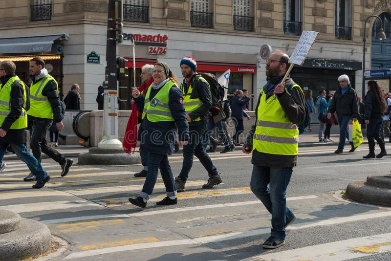 Yellow vests Gilets jaunes protesters in Paris, France. Paris, France - 22nd March, 2019: yellow vest protesters marching in the street in the downtown of Paris stock image