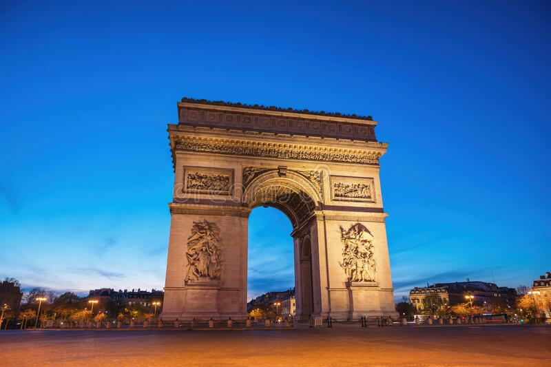 Paris France night at Arc de Triomphe and Champs Elysees royalty free stock images