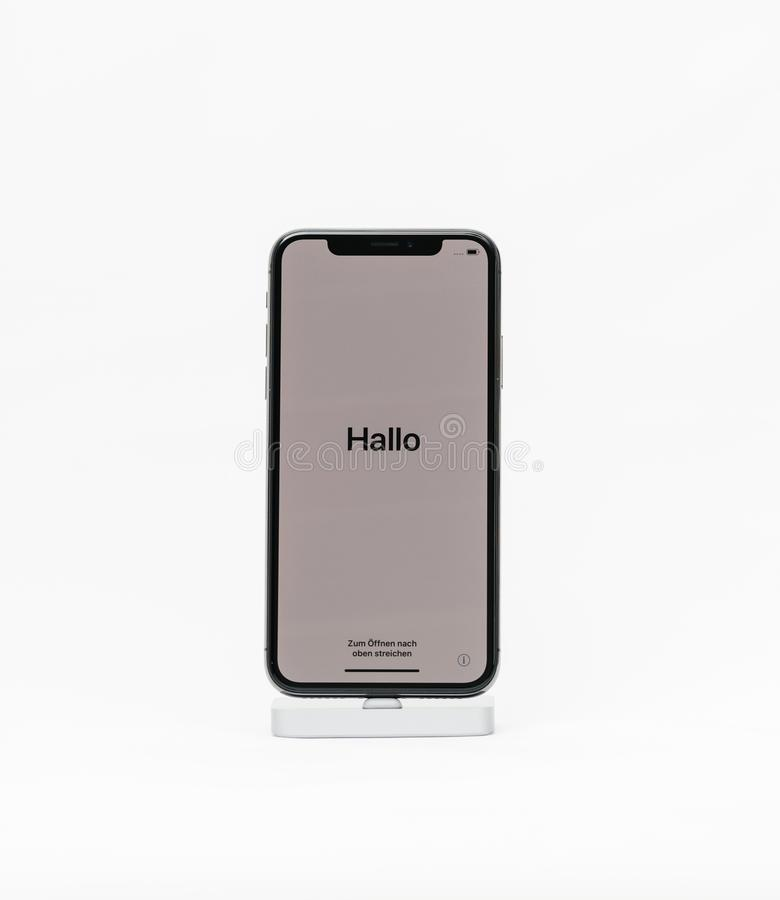 Apple iPhone X isolated white background with hello word in Germ stock images