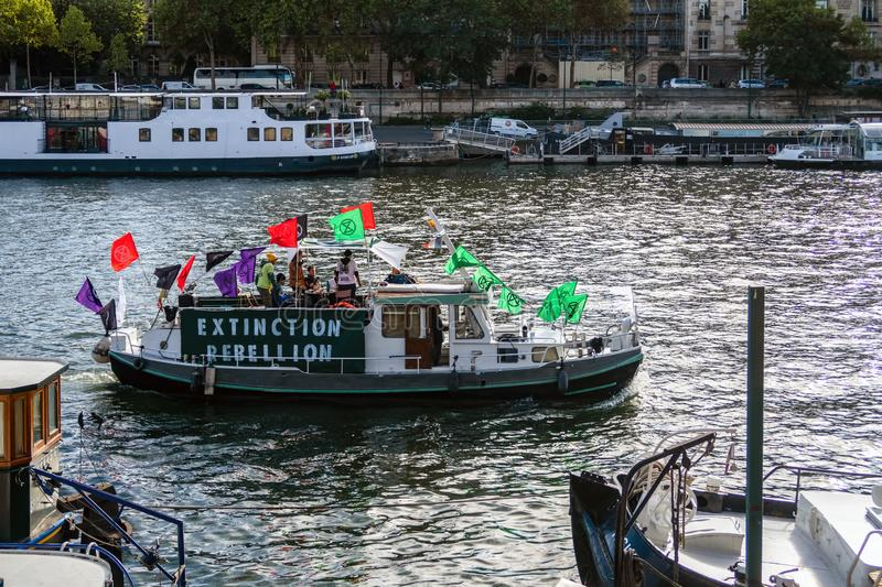 Boat of the Extinction Rebellion movement on Seine River royalty free stock photography