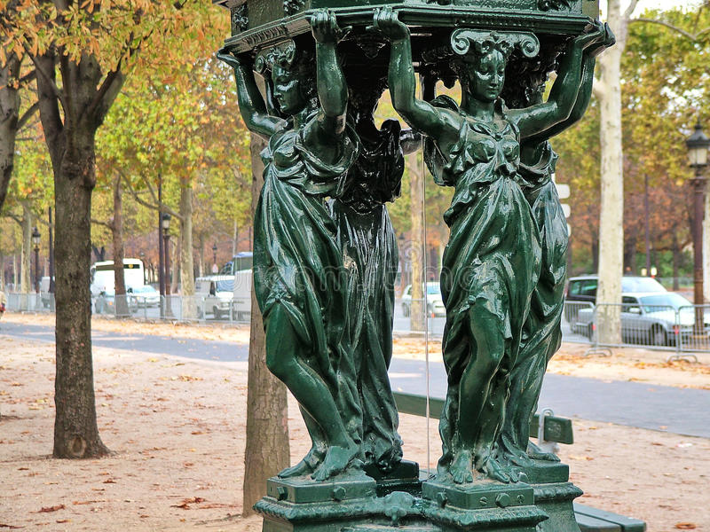 Paris, France -17 October 2005 - Caryatids of the Wallace fountain on the Champs Elysees. In the fall, soft focus royalty free stock image