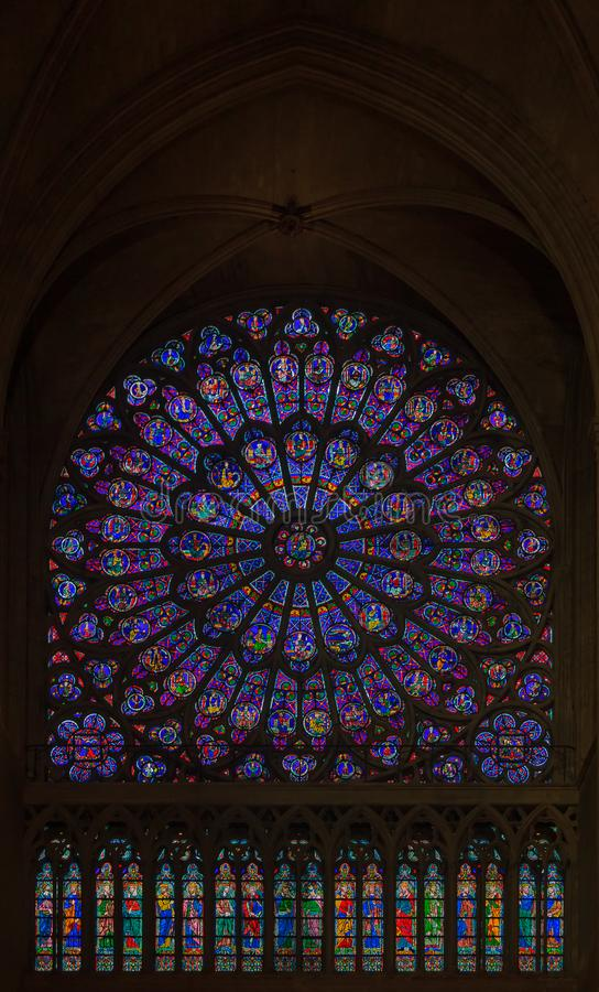 Closeup of stained glass of the oldest rose window installed in 1225 in the Notre Dame de Paris Cathedral in Paris France. Paris, France - October 25, 2013 stock photos