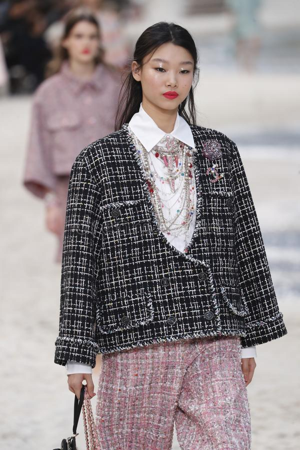 A model walks the runway during the Chanel show as part of the Paris Fashion Week Womenswear Spring/Summer 2019. PARIS, FRANCE - OCTOBER 02: A model walks the royalty free stock photo
