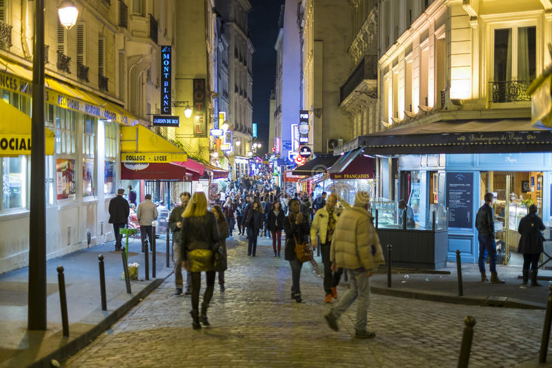 Paris, FRANCE - OCTOBER 19: Night shot of busy Rue de la Huchette with lots of pedestrians. October 19, 2013 in Paris. royalty free stock photography